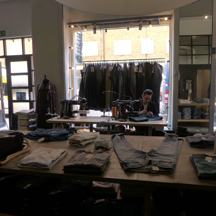 Nudie Jeans, I liked the design of the store. They offer repair on all jeans bought from them.