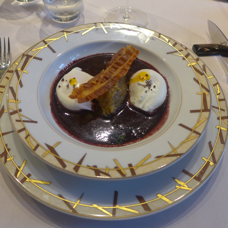 Poached Eggs Meurette in a Bernard Loiseau Red WIne Sauce, Onion Confit and Crusty Bacon.