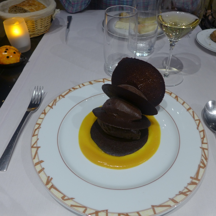 Rose des Sables Bernard Loiseau. Thin chocolate biscuits with dark chocolate ice cream and orange coulis.