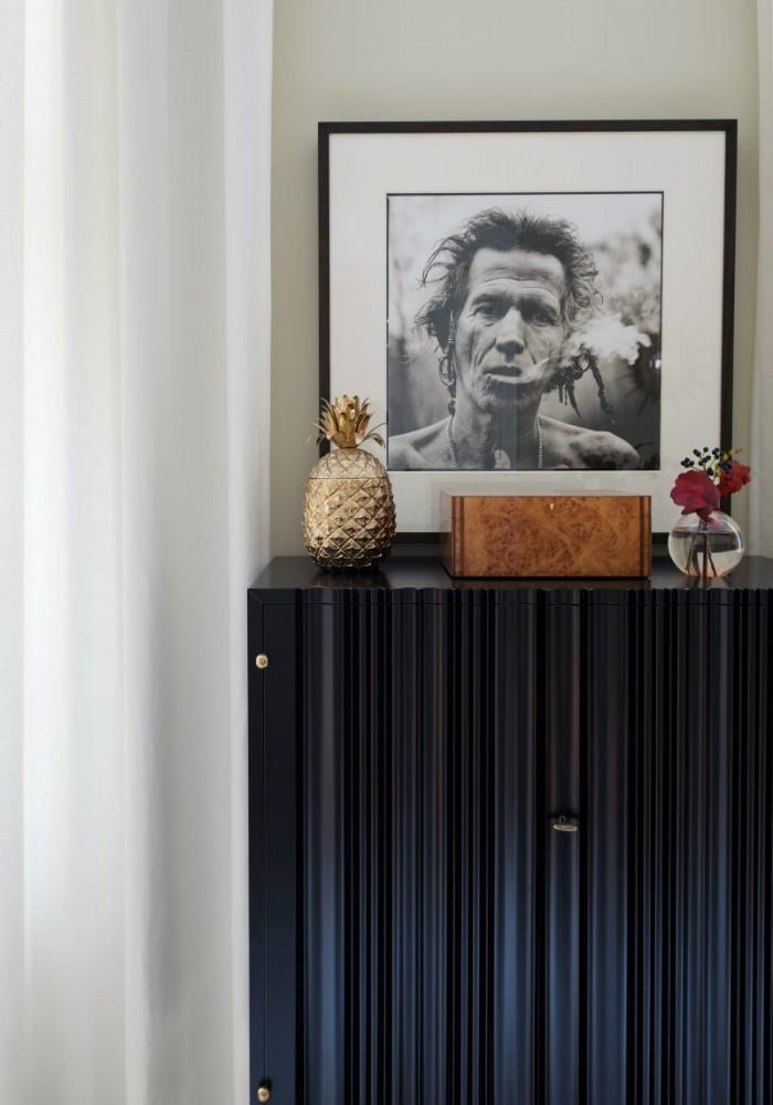 Keith Richards by Anton Corbijn above a Josef Frank Cabinet from Svensk Tenn.