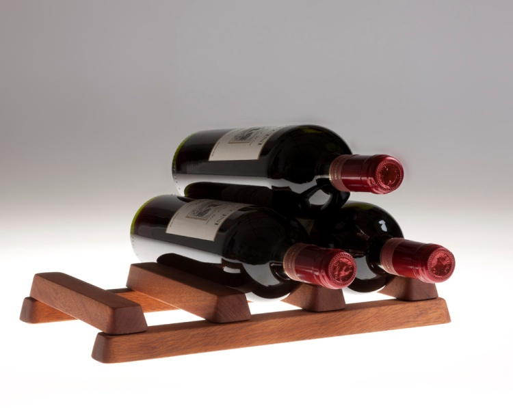 Vinetta, a fold up wine rack made from Mahogany.