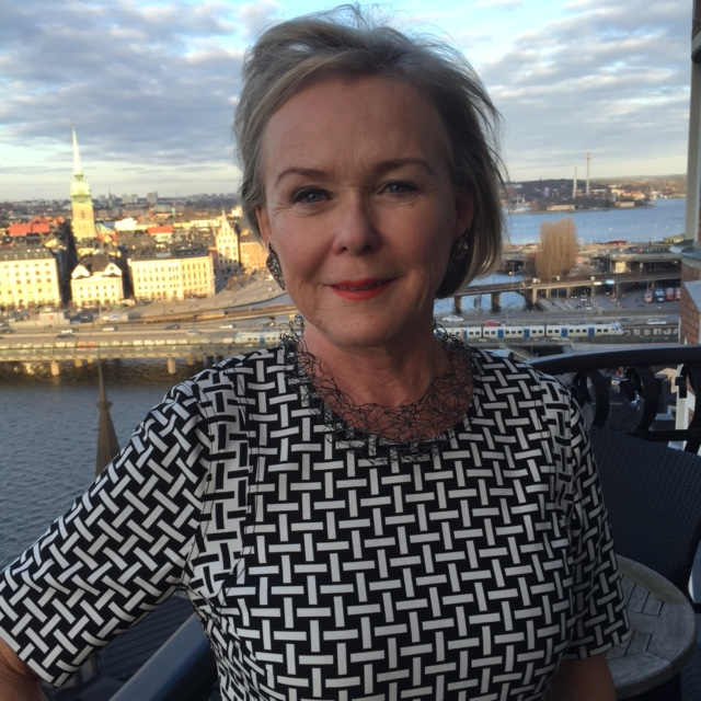 Inger Wästberg wearing a Jenny Edlund necklace on the balcony of her home in Stockholm.