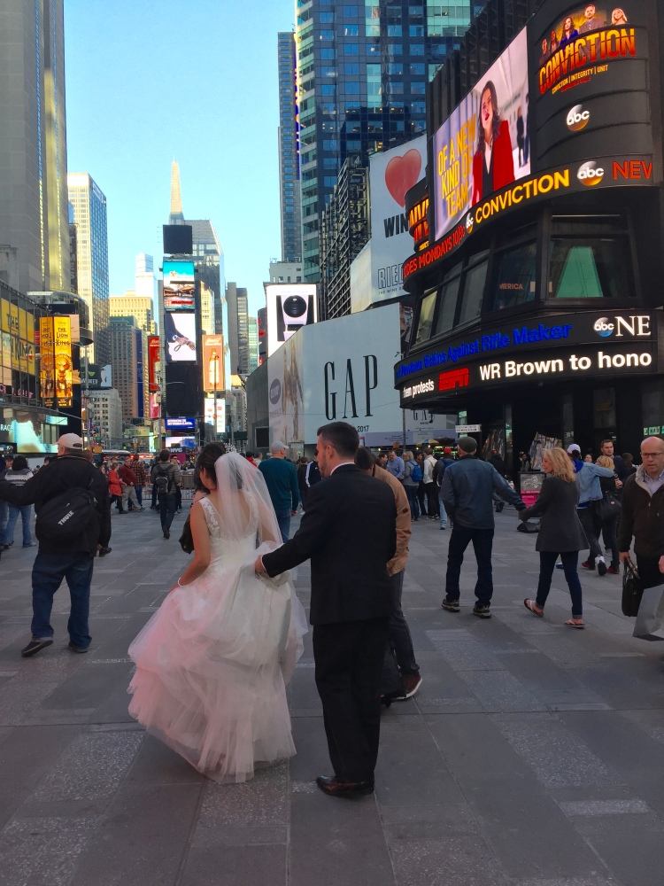 Bride in the madness of Times Square.